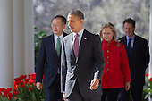 United States President Barack Obama, center, walks out of the Oval Office with Jim Yong Kim, president of Dartmouth College and nominee to become president of the World Bank, left, U.S. Secretary of State Hillary Rodham Clinton, and U.S. Secretary of the Treasury Timothy Geithner, to make a speech in the Rose Garden of the White House in Washington, D.C., U.S., on Friday, March 23, 2012. Kim was born in Seoul and is a U.S. citizen. He would succeed Robert Zoellick as the head of the bank. The bank made $57 billion loans in the last fiscal year. .Credit: Andrew Harrer / Pool via CNP