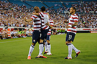 Jacksonville, FL - Saturday, May 26, 2012: Landon Donovan is congratulated by Terrence Boyd, left and Jermaine Jones, right as the USMNT defeated Scotland 5-1 during an international friendly match.