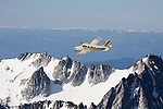 Seneca aircraft owned by Wings of Wenatchee flying over Stuart Range in Washington Cascades.