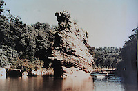 Courtesy photo<br /> A paddler in a jon boat floats past a large rock in the White River one-half mile to a mile south of Arkansas 12. Beaver Lake now covers the rock estimated to be 60 feet tall.