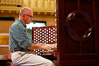 Bob Troeger, director of music and organist for St. Matthew's Church, plays their new digital organ at St. Matthew's Church in Wheeling, West Virginia on August 3, 2015.  (Jared Wickerham for the Boston Globe)