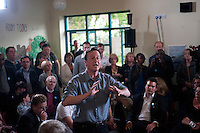 Conservative Party leader David Cameron speaks to voters at an election campaign stop at the Rush Green Medical Centre in Dagenham, East London.