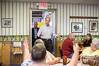 Vice President Joe Biden approaches the table of Sandra Axdale, Barb Baker, Kim Thompson, and.Char Thompson during an unannounced stop at the Good Earth Restaurant during a two-day campaign swing through Iowa on Monday, September 17, 2012 in Muscatine, IA.