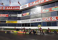 Feb 14, 2016; Pomona, CA, USA; Crew members push NHRA top fuel driver J.R. Todd during the Winternationals at Auto Club Raceway at Pomona. Mandatory Credit: Mark J. Rebilas-USA TODAY Sports