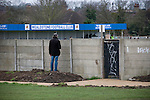 Wealdstone 0 Newport County 0, 17/03/2012. St Georges Stadium, FA Trophy Semi Final. A solitary spectator looking over the perimeter wall at St Georges Stadium, home ground of Wealdstone FC, before the club played host to Newport County in the semi-final second leg of the F.A. Trophy. The game ended in a goalless draw, watched by a capacity crowd of 2,092 which meant the visitors from Wales progressed by three goals to one to the competition's final at Wembley, where they would meet York City. The F.A. Trophy was the premier cup competition for non-League clubs in England and Wales affiliated to the Football Association. Photo by Colin McPherson.