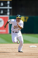 6 April 2008: A's #24 Kurt Suzuki runs toward third base during the Cleveland Indians 2-1 victory over the Oakland Athletics at the McAfee Coliseum in Oakland, CA.