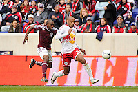 Thierry Henry (14) of the New York Red Bulls is chased by Marvell Wynne (22) of the Colorado Rapids. The New York Red Bulls defeated the Colorado Rapids 4-1 during a Major League Soccer (MLS) match at Red Bull Arena in Harrison, NJ, on March 25, 2012.