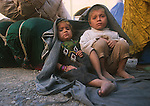 Afghan refugee children at Jalozai, Pakistan, wait for their transfer to a new refugee camp on the border..
