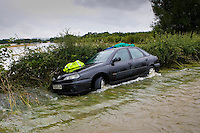 Car forced off the road by flooding in Lyneham, Oxfordshire, England, United Kingdom