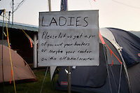 A sign asks passing women to expose their breasts at the Testicle Festival at the Rock Creek Lodge in Clinton, MT.  The Rock Creek Lodge in Clinton, MT, has hosted the annual Testicle Festival since the early 1980s.  The four day festival and party revolves around the consumption of so-called Rocky Mountain Oysters, which are deep-fried bull testicles.
