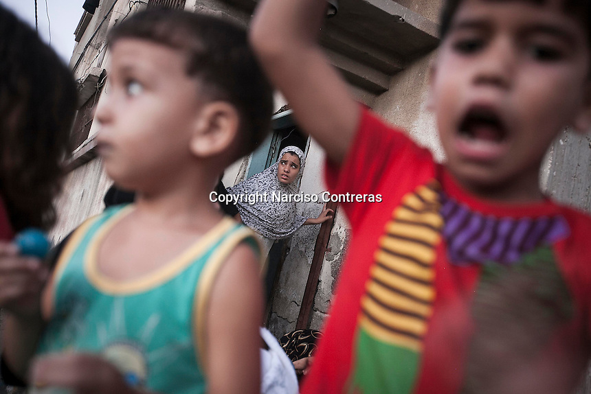 "August 26, 2014 - Gaza City, Gaza strip, Palestinian Territory: Palestinians residents celebrate as new cease fire is announced between Hamas and Israel. The new cease fire marks the end of the ""Protective Edge"" Israeli military operation in the Gaza strip. (Narciso Contreras/Polaris)"