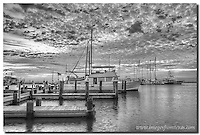I like the way this black and white image from Rockport, Texas displays the contrasts in light from the ocean to the sky. This morning, the clouds were magnificient, and the waters relatively calm.