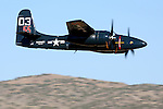 Grumman F7F Tigercat in flight during the Reno National Championship Air Races. There were 364 of the twin engined fighters built during World War II, and shortly thereafter, of which there are six that are still considered airworthy. Originally Grumman had been contracted to build 500 of the aircraft for use by the US Marine Corps to be used as close air support of the landing operations that were planned in the Pacific.