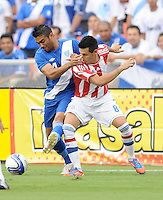 Guatemala defender Carlos Gallardo (4) goes against Paraguay midfielder Hernan Perez (8)   Guatemala tied Paraguay 3-3 in a international friendly match at RFK Stadium, Wednesday August 15, 2012.