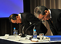 December 7, 2011, Tokyo, Japan - President Shuichi Takayama, left, and his accounting manager Nobuyuki Onishi of the scandal-hit Olympus Corp. bow to the media before leaving a news conference in Tokyo on Wednesday, December 07, 2011, a day after an independent panel set up by the Japanese optical equipment company released the results of its investigation into the companys cover-up of investment losses. Takayama hinted at the news conference that the companys top brass may step down at the next shareholders meeting, most likely in February 2012 at the earliest. Former President Michael Woodford is calling for an extraordinary shareholders meeting to discuss the accounting scandal. (Photo by Natsuki Sakai/AFLO) [3615] -mis-