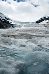 Looking at Athabasca glacier from the toe of the glacier with water running over the ice