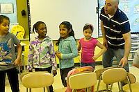 Teacher Mr. Mohamed Mamdouh teaches Arabic to first and second graders at P.S. 368-Hamilton Heights School in Harlem in New York on Wednesday, May 23, 2012. The program is the first at the K-5 school level in New York City Public Schools.  © Frances M. Roberts)