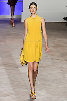 Jacquelyn Jablonski walks the runway in a Yellow silk sleeveless placket front button-down shirtdress with pleated top, by Tommy Hilfiger for the Tommy Hilfiger Spring 2012 Pop Prep Collection, during Mercedes-Benz Fashion Week Spring 2012.