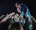 Photo by Phil Grout..Country singing sensation Blake Shelton leans into the concert crowd.with another hit as the fans reach for the star during a special Ft. Meade performance Friday night.