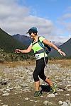 NELSON LAKES, NEW ZEALAND - APRIL 18:  Nicki Robinson crosses the Travers River during the 2015 Alpine Lodge Loop The Lake trail run at Lake Rotoiti on April 18 16, 2015 in Nelson, New Zealand. (Photo by Marc Palmano/Shuttersport Limited)