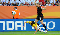 Amy Rodriguez (r) of team USA and Formiga of team Brazil during the FIFA Women's World Cup at the FIFA Stadium in Dresden, Germany on July 10th, 2011.