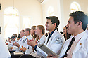 Cheng-Wei Huang, right, Suleiman Ismael, Sarah Johnson. Class of 2016 White Coat Ceremony.