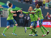 Seattle Sounders FC midfielder Osvaldo Alonso  celebrates scoring a goal with teammates including defender James Riley during play against the New York Red Bulls at Qwest Field in Seattle Saturday June 23, 2011. The Sounders won the game 4-2.