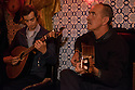Lisbon, Portugal. 26.03.2015. Fado guitarists, playing in a restaurant in Alfama, Lisbon, Portugal. © Jane Hobson.
