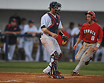 Ole Miss' Taylor Hightower (13) awaits the throw as Georgia's Curt Powell (8) scores in college baseball action at Oxford-University Stadium in Oxford, Miss. on Friday, April 8, 2011. Georgia won 9-8.