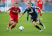 25 September 2010:  Toronto FC forward Chad Barrett #19 and San Jose Earthquakes defender Chris Leitch No.3 in action during a game between the San Jose Earthquakes and Toronto FC at BMO Field in Toronto..San Jose Earthquakes won 3-2...