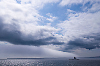 Dramatic weather over Gull Rock Lighthouse on Lake Superior near Copper Harbor Michigan.