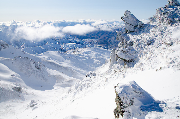 Snowy mountains and rocky outcrops on top of Cardrona range. Picture taken from behind ski area looking towards cardrona valley and wanaka Hawea.