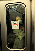 A female passenger squashed against the glass on a train during rush-hour in Shinjuku Station, Tokyo, Japan. With up to 4 million passengers passing through it every day, Shinjuku station, Tokyo, Japan, is the busiest train station in the world. The station was used by an average of 3.64 million people per day.  That&rsquo;s 1.3 billion a year.  Or a fifth of humanity. Shinjuku has 36 platforms, and connects 12 different subway and railway lines.  Morning rush hour is pandemonium with all trains 200% full. <br /> <br /> Photo by Richard jones / sinopix