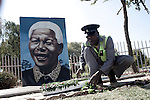 SOWETO, SOUTH AFRICA : A caretaker cleans a garden at a Nelson Mandela memorial in Thokoza park close to Regina Mundi church in Soweto, South Africa. . (Photo by: Per-Anders Pettersson)....