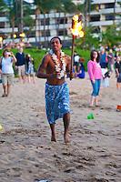 Tiki torch lighting ceremony at sunset, Ka'anapali Beach, Maui