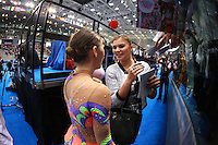 (L-R) Mojca Rode of Slovenia and Alina Kabaeva, 2004 Olympic champion from Russia share happy moment during autograph session at 2008 European Championships at Torino, Italy on June 6, 2008.  Photo by Tom Theobald.