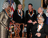 Washington, DC - December 5, 2009 -- 2009 Kennedy Center honorees share some thoughts after posing for the formal group photo following the Artist's Dinner at the United States Department of State in Washington, D.C. on Saturday, December 5, 2009.  From left to right: Grace Bumbry, Robert De Niro, Bruce Springsteen, Mel Brooks, and Dave Brubeck. .Credit: Ron Sachs - Pool via CNP