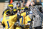 06 February 2016: Michigan's Kyle Jackson (CAN) (47) celebrates his goal with teammates. The University of North Carolina Tar Heels hosted the University of Michigan Wolverines in a 2016 NCAA Division I Men's Lacrosse match. UNC won the game 20-10.