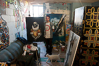 Efren De La Cruz, painter, at his apartment in Mexicali, Mexico.<br />
