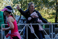 New York City, NY. 02 November 2014. a woman yells to Runners as they attend the 29th New York City Marathon as they arrive to Central park.