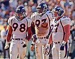 Oakland Raiders vs. Denver Broncos at Oakland Alameda County Coliseum Sunday, September 20, 1998.  Broncos beat Raiders  34-17.  Denver Broncos defensive end Maa Tanuvasa (98), defensive tackle Trevor Pryce (93) and nose tackle Mike Lodish (97).
