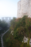 LES ANDELEYS, FRANCE - OCTOBER 10: Detail of the embossed rampart of the Chateau Gaillard in a fog, on October 10, 2008 in Les Andelys, Normandy, France. The chateau was built by Richard the Lionheart in 1196, came under French control in 1204 following a siege in 1203. It was later destroyed by Henry IV in 1603 and classified as Monuments Historiques in 1852. (Photo by Manuel Cohen)