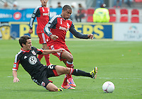 06 October 2012: D.C. United midfielder Lewis Neal #24 and Toronto FC foward/midfielder Ryan Johnson #9 in action during an MLS game between DC United and Toronto FC at BMO Field in Toronto, Ontario Canada. .