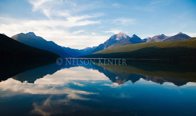Evening light at Bowman Lake. Glass smooth lake and mountains of the Lewis and Clark Range in Montana's Glacier National Park