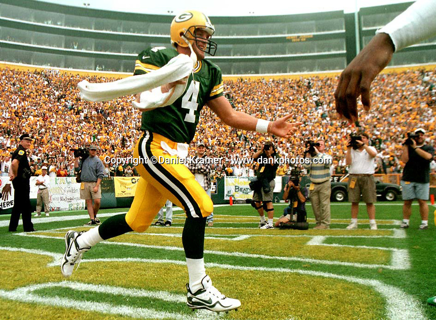Brett Favre is introduced to the fans at the beginning of the September 14, 1997 game against the Miami Dolphins at Lambeau Field.