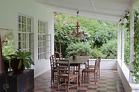 A simple dining area is located at one end of the generous veranda