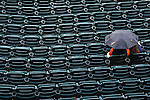 April 23, 2013; Detroit, MI, USA; Fans wait under an umbrella during a rain delay in the game between the Detroit Tigers and the Kansas City Royals at Comerica Park. Mandatory Credit: Rick Osentoski-USA TODAY Sports