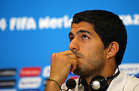 Luis Suarez of Uruguay looks disinterested during a press conference ahead of his sides Group D fixture vs Italy tomorrow