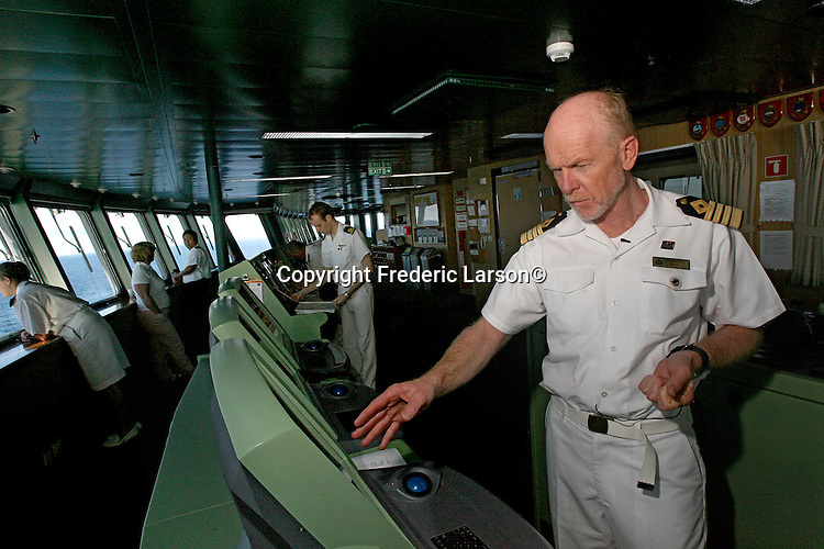 Captain Christopher Rynd stands on the bridge of the Queen Mary 2 is in command of the grandest ocean liner ever built that will stop in San Francisco on its maiden call.
