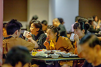 Staff eating a meal in the Marina Bay Sands' dining room for the employees where they serve meals 24 hours a day to the 9,000 workers.